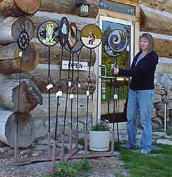 Stained Glass And Wrought Iron Garden Ornaments At Her Treehouse Glass  Studio. It Will Be Auctioned Off At Sebagou0027s Artisan Fair In July.